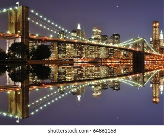 The Lower Manhattan Skyline and Brooklyn Bridge with serious reflections in New York City.
