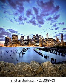 Lower manhattan skyline long exposure seen from Brooklyn Bridge Park in NY at sunset