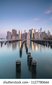 Lower Manhattan view from broken pier at sunrise