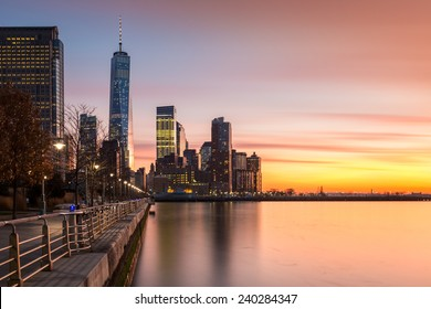 Lower Manhattanat sunset as viewed from Hudson River Park, in Tribeca, New York - with space for text on the right