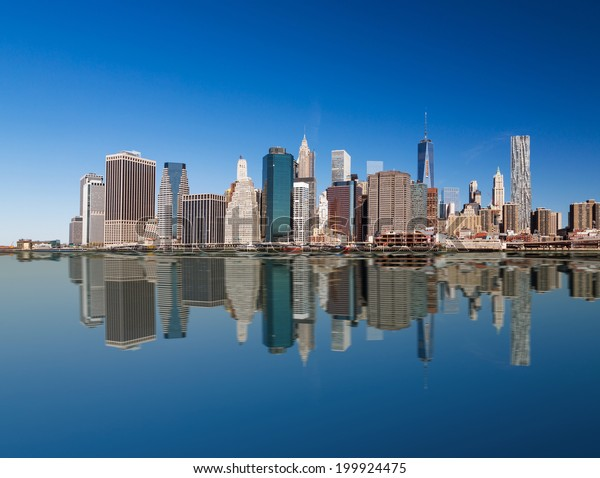 Lower Manhattan's fabulous skyscrapers and a pure reflection of them in a water, New York, USA.