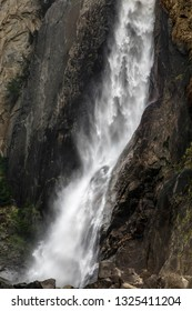 The lower portion of one of America's tallest waterfalls, Yosemite Falls in California's Yosemite National Park, is seen with falling sheets of water splashing down on rocks below.