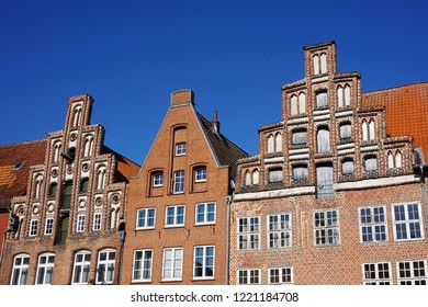 Lüneburg, Lower Saxony, Germany, October 11, 2018. Close Up View of the Façades of three Quaint Houses in the Town's Historic Centre