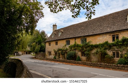 Lower Slaughter, Cheltenham / England - 09/12/2019: Traditional Cotswold stone buildings in Lower Slaughter,