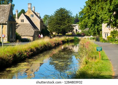 Lower Slaughter, Gloucestershire, UK - 19th July 2016: Summer sunshine brings visitors to the picturesque Cotswold village of Lower Slaughter, Gloucestershire, UK.