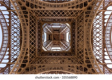 Lower view of Eiffel Tower in Paris, France.