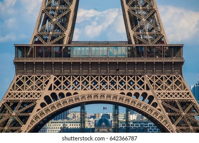 Lowest arch of Eiffel Tower Tour Eiffel blue sky steel structure