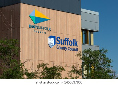 LOWESTOFT, SUFFOLK, ENGLAND, UK - JULY 14, 2019: East Suffolk Council and Suffolk County Council sign and logo on their office building in Lowestoft.