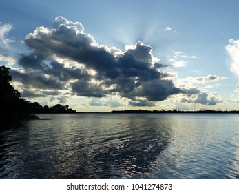 Low-hanging clouds over the river Mamori in the Amazon, Brazil