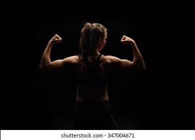 Low-key fitness model flexing