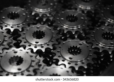 lowkey light photo style of metal sprocket in black background