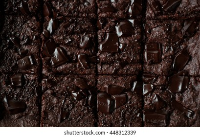 A low-key photo of dark chocolate chunk brownies