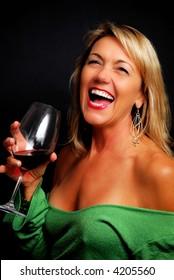 Low-key sexy blond model glamor portrait with wine glass