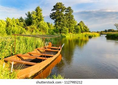 Lowland Nida river, wooden boat, landscape of the Nida Valley, Poland.