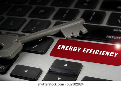 Lowlight key and keyboard with energy effienciency words. Business concept