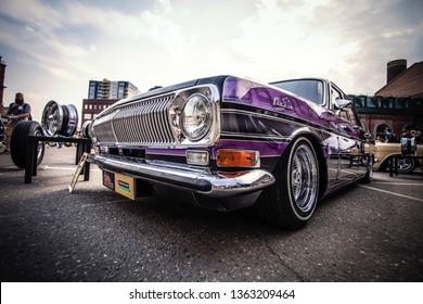"Lowrider tuned car GAZ ""Volga 24"" during custom auto festival Custom Convention Russia. July 29, 2018, Moscow, Russia."