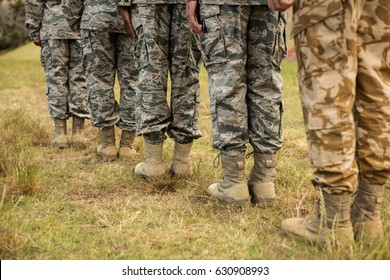 Low-section of military soldiers standing in line at boot camp