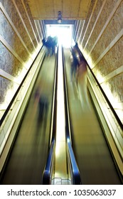 low-speed creative photography of escalators with an effect caused by people moving and blurred, in Toledo, Spain,
