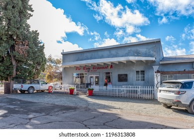 LOXTON, SOUTH AFRICA, AUGUST 7, 2018: Die Rooi Granaat, a restaurant and deli in Loxton in the Northern Cape Province. Vehicles are visible