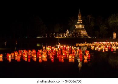 Loy Krathong  at Sukhothai Historical Park, Sukhothai (Thailand).Image contain certain grain or noise.Image is Soft focus.