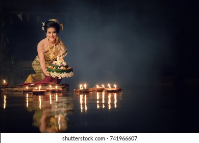 Loy Krathong Traditional Festival, Thai woman hold kratong, Thailand, Asia woman in Thai dress traditional hold kratong and bring Krathong to float in Loi kratong day of Thailand.