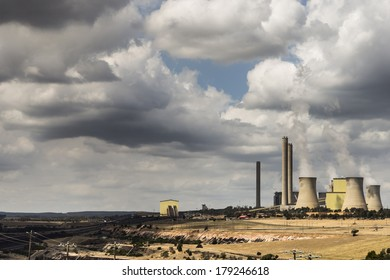 LOY YANG, VICTORIA, AUSTRALIA - MARCH 1, 2014 - The Loy Yang power station in seen on the right with the coal mind to the left. The La Trobe Valley is rich in brown coal: the fuel for power stations.
