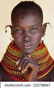 LOYANGALANI - KENYA - JANUARY 22, 2015: Unidentified beautiful Turkana woman with traditional headdress and necklace on January 22, 2015 in Loyangalani, Kenya.