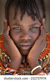 LOYANGALANI - KENYA - JANUARY 23, 2015: Unidentified beautiful Turkana girl with traditional necklace on January 23, 2015 in Loyangalani, Kenya.