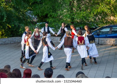 Loznica, Serbia - July 11, 2019: A national festival with a regional folk authentic tradition. Serbian National Folklore dancing Kolo.