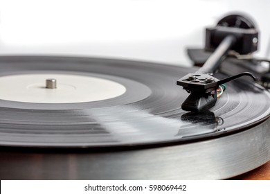 LP on turntable, record spins on a turntable
