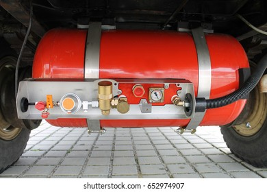 A LPG gas tank under a motorhome. It's installed between the wheels under the camper.  The lpg gas in the 90 l gas tank can be used for cooking or heating. There you can see the control panel.