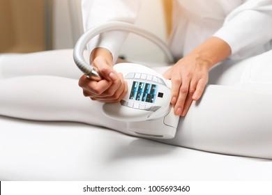 Lpg massage procedure. Hands of therapist holding lipomassage tool. Close up, selective focus.