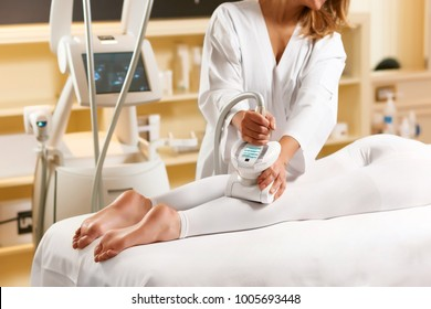 Lpg massage procedure on legs. Close up, selective. Naked feet