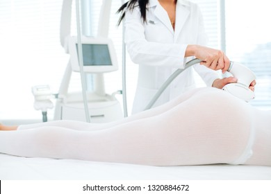 LPG skin massage in professional beauty studio. Midsection sot of woman's body receiving LPG skin care. Hardware technology, Weightloss, Anti Cellular Therapy, Bodycare