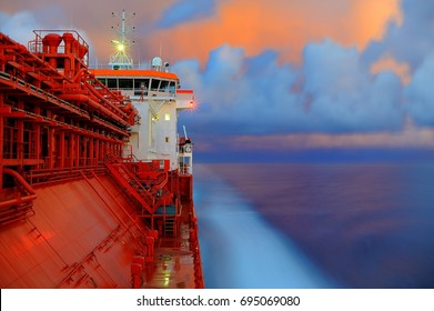 LPG tanker during sea passage with background of amazing sunset clouds.