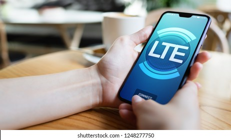 LTE, 5G, Mobile technology and telecommunication concept on smartphone screen.