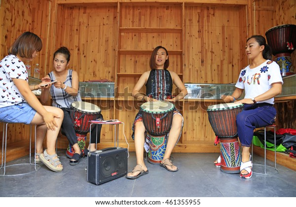 LUAN COUNTY - July 16: African drum performances in wooden house, on July 16, 2016, Luan County, Hebei Province, China