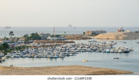 Luanda Yacht Club or Clube Naval de Luanda with many boats at Luanda Bay in the capital of Angola, Africa