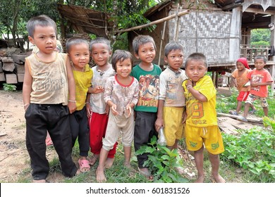 Luang Namtha prov., Laos-October 6, 2015: The Akha hill tribe are an ethnic minority living in the mountains between E.Myanmar-N.Thailand-W.Laos-S.China. Kids greet the tourists visiting their village