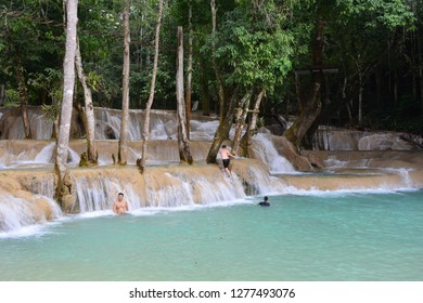 LUANG PRABANG, LAO - DEC 7TH, 2018: Tad Sae waterfall, a famous tourist destination in Luang Prabang, Lao, on Dec 7th, 2018