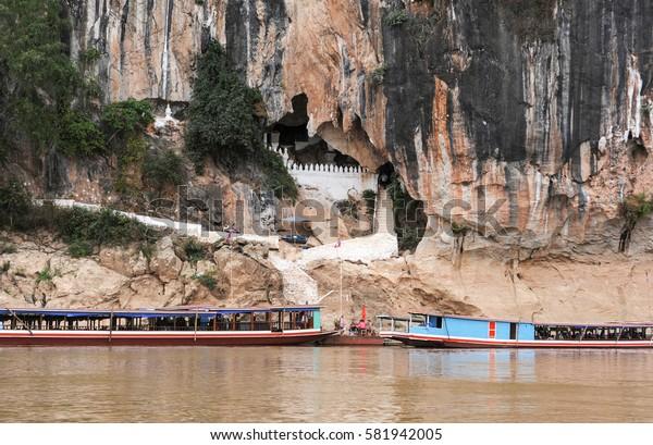 Luang Prabang , Laos -  11 January 2012: people on boat resting at Pak Ou caves in Luang Prabang, Laos