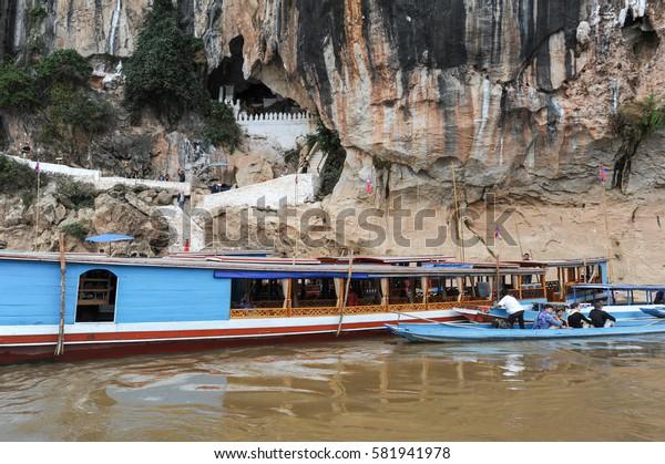 Luang Prabang , Laos -  13 January 2012: people on boat resting at Pak Ou caves in Luang Prabang, Laos
