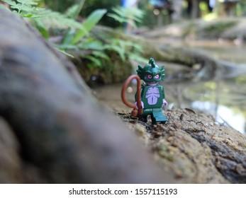 Luang Prabang, Laos - 27 Oct 2019: Lego Swamp Creature walking from the Kuangsi waterfall