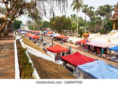 LUANG PRABANG, LAOS - APRIL 14, 2019. Local Lao people celebrating Pi Mai, at the market. Lao New Year, big water festival