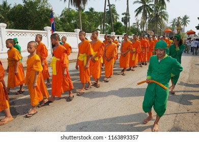 Luang Prabang, Laos - April 16, 2012: Unidentified young monks take part in the religious procession during Lao New Year celebration in Luang Prabang, Laos.