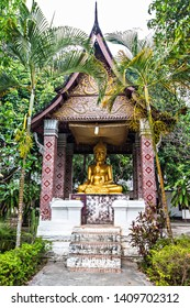 LUANG PRABANG, LAOS - April 2019: Golden Buddha image in old Buddhist temple in Luang Prabang, Laos