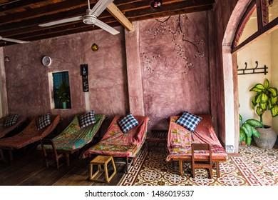 LUANG PRABANG, LAOS - April 2019: Interior of spa and massage saloon in Luang Prabang, Laos. Cozy relaxing beds in massage saloon in Thailand and Laos