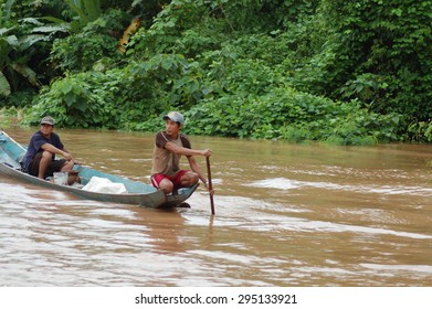 LUANG PRABANG, LAOS - Aug, 11: Unidentified people sailing on a canoe down the Mekong river on August, 11, 2008 in Luang Prabang, Laos