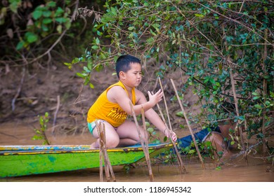 LUANG PRABANG , LAOS - AUG 12 : Laotian fisherman at the Mekong river in Luang Prabang Laos on August 12 2018 , The Mekong is one of the longest rivers of Asia
