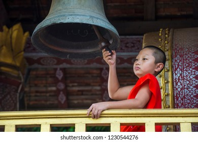 LUANG PRABANG , LAOS - AUG 12 2018 : Novice monk in Luang Prabang Laos on August 12 2018. It is estimated that about 1 in 3 male Laotians join a monastery at least for a while